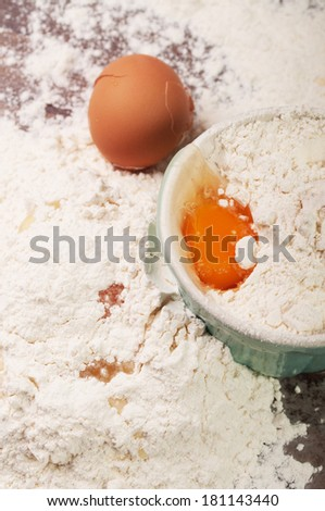 Messy kitchen table with eggs and flour