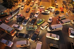 Messy traffic at crossroad in China. Night Time, aerial view