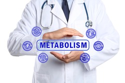 Metabolism concept. Doctor with stethoscope on white background, closeup