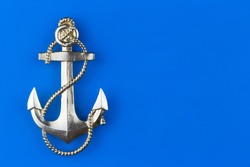 metal anchor on a blue background