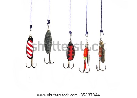 metal angling baits on white background