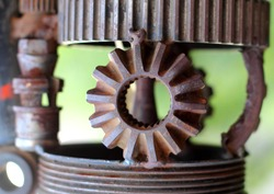 Metal art in the style of steampunk, close-up, gears, pistons, bushings