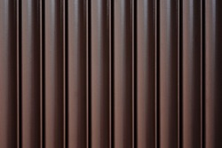 Metal automatic sliding gates close up. Vertical construction sections background, house exterior, fencing.