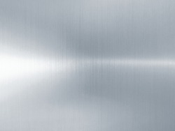 Metal background - metallic texture of shiny brushed steel silver aluminum stainless alloy foil sheet