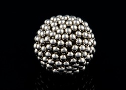 metal ball made from multiple small spheres with reflection isolated on black background