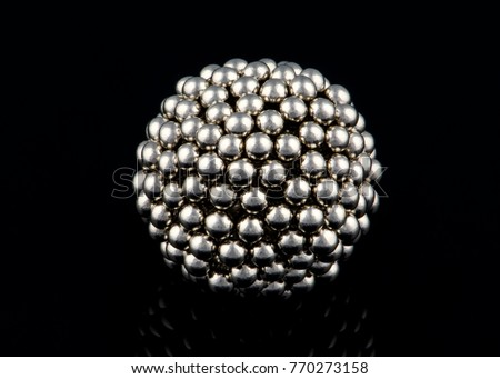 metal ball made from multiple small spheres with reflection isolated on black background #770273158