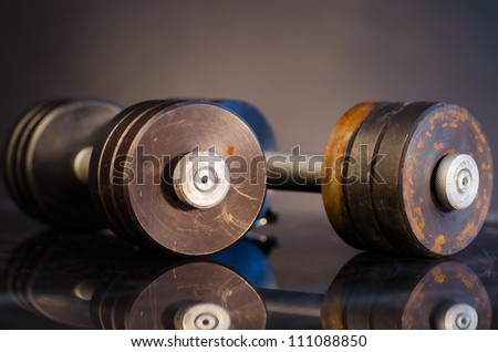 metal barbells on dark gray background