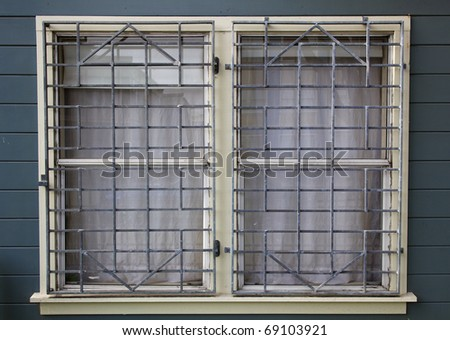 Metal barred or grated security installed on two windows