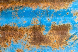 Metal barrel with blue paint and rust