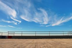 Metal barrier or railings between promenade and blue sky