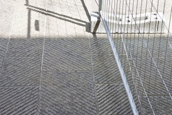 Metal barrier to stop traffic or construction site in a stone road.