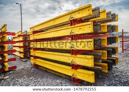 Metal beams and wooden beams on the construction of the bridge #1478792255