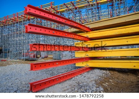 Metal beams and wooden beams on the construction of the bridge #1478792258