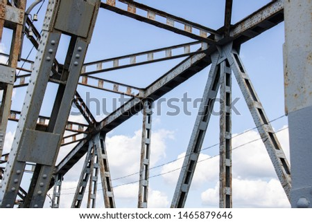 Metal beams on the sky with clouds background #1465879646