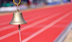 metal bell to signal the last lap of the race in the athletics stadium