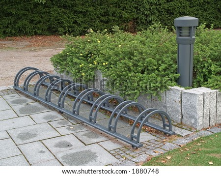 Metal bicycle storing device in a park, close-up