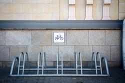 Metal bike rack by the tiled wall
