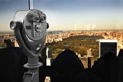 Metal binoculars overlooking Central Park, at Manhattan