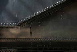 Metal black steam punk background. Grunge background metal plate with screws
