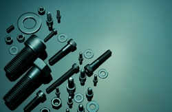 Metal Bolts, nuts, and washers. Fasteners equipment. Hardware tools. Stud bolt, flat washers, hex nuts, and hex head bolts in workshop. Threaded fastener use in automotive engineering. Hexagonal bolt.