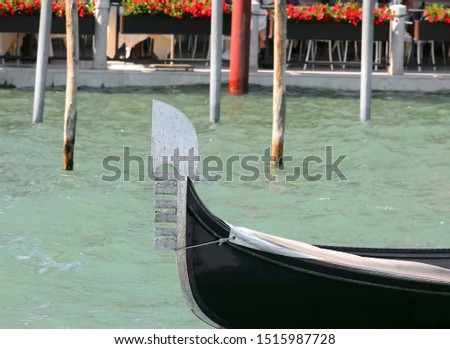 metal bow of a boat called GONDOLA typical nautic vessel in Venice in Italy #1515987728