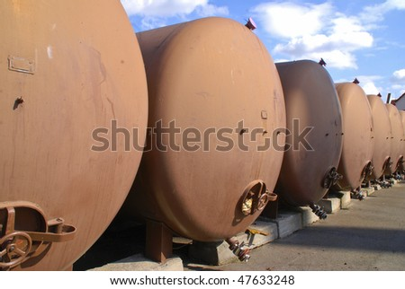 Metal brown tanks for fuel storage in a row