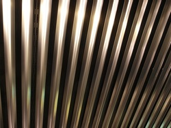 Metal ceiling background. New shiny metal plates and bars
