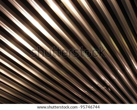 Metal ceiling background. Shiny metal bar pattern