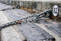 metal chains at a lake como