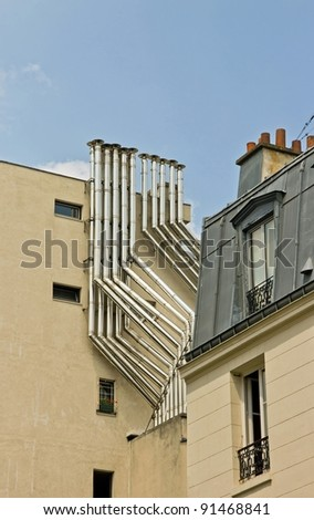 metal chimney on a building in town (Paris France)