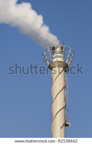 Metal chimney with a white smokestack