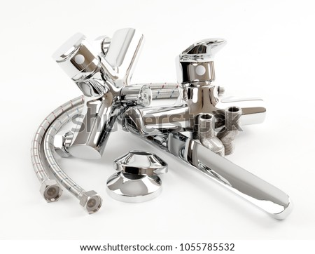 Metal chromed Bathroom Faucets, Hoses, Eccentrics and decorative Reflectors on a white background. Set of parts for the bath mixer