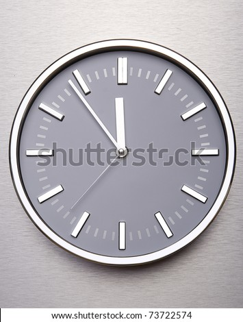 Metal clock on the wall of steel