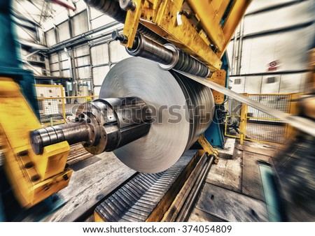 Metal coils machine. Interior of factory. Business concept.