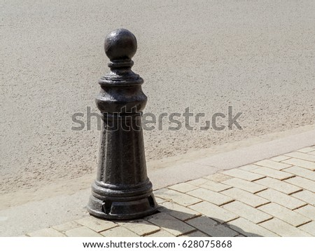 Metal column on the sidewalk
