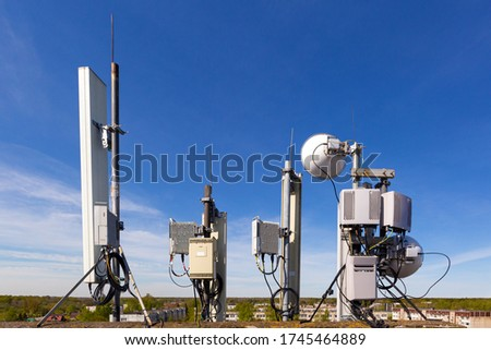 Metal constructions for telecommunication data equipment , radio panel antennas, outdoor remote radio units, power cables, coaxial cables, optic fibers. Outside part of telecommunication basic station ストックフォト ©