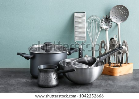 Metal cooking utensils on table Stock photo ©