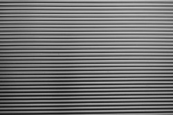 Metal corrugated background with free space for text. Gray wavy grooved metal texture, copy space