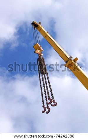 Metal crane on a blue sky