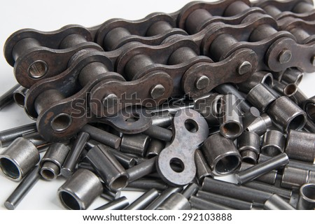 Metal cylinders - elements of the industrial roller chain isolated on white background