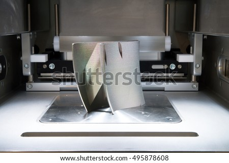 Metal 3D printers (DMLS). Direct metal laser sintering (DMLS) is an additive manufacturing technique that uses a Ytterbium fibre laser fired into a bed of powdered metal. #495878608
