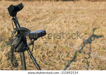 Metal detector in the field, special equipment for treasure hunt