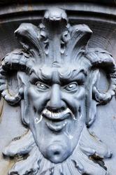 Metal devil sculpture