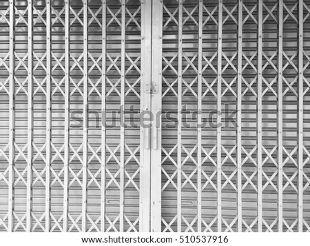 Metal door with black and white style.Vintage slide steel locked shutter  door,abstract - Free Photos Antique Slide Steel Locked Shutter Door For Antique