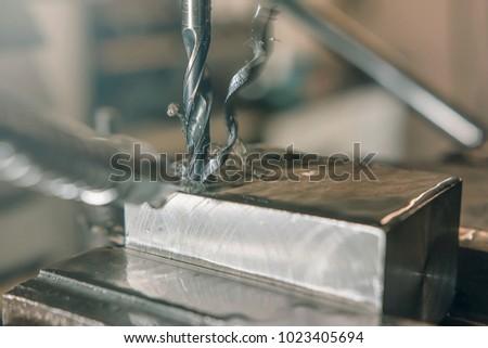 Metal drilling closeup. Metal workshop. #1023405694