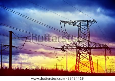 Metal electric pole on a blue sky background