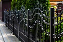 Metal Fence. Modern iron wall.