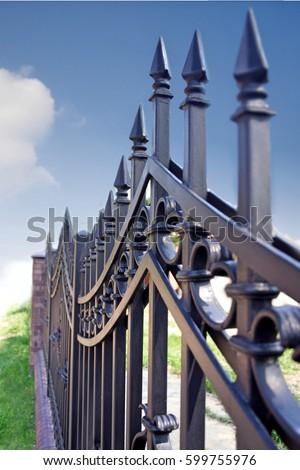 Metal fence over blue sky #599755976
