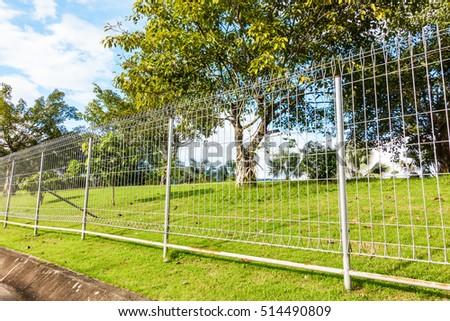 Metal fence wire in plublic garden #514490809