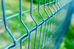 Metal fence wire, painted in blue color.